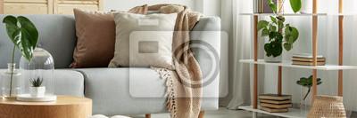 Fototapeta Close-up of gray comfortable sofa in modern apartment - panorama
