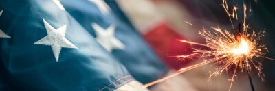 Fototapeta Close-up Of Vintage American Flag With Sparkler And Smoke - Fourth Of July Background