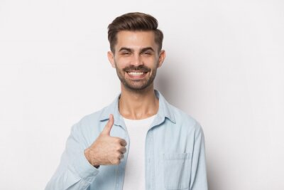 Fototapeta Close up portrait with smiling handsome bearded man thumbs up.