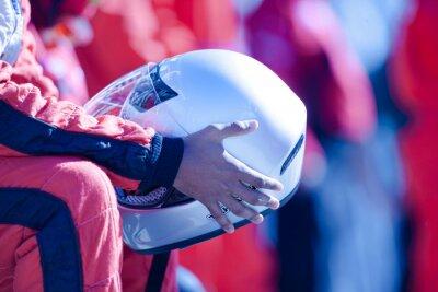 Fototapeta Close up racer holding helmet
