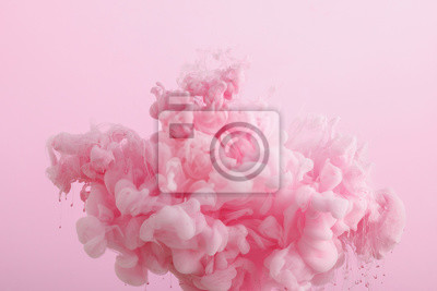 Fototapeta Close up view of pink smoky paint in water isolated on pink