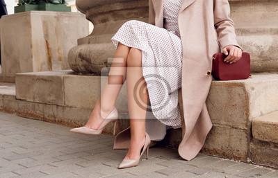 Fototapeta Closeup fashion woman legs in beige high heel shoes, dress.