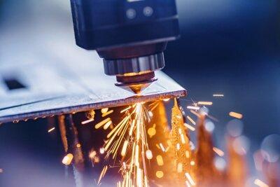 Fototapeta CNC laser machine cutting sheet metal with light spark. Technology plasma industrial, Blue steel color