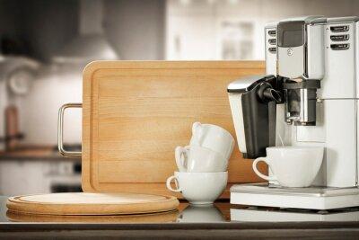 Coffee machine and blurred kitchen interior.