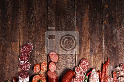 cold meat assortment with delicious salami and  fresh herbs . Variety of meat products including coppa and sausages