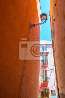 Colorful houses in the alleys of the town of Bosa in Sardinia in sunlight in spring