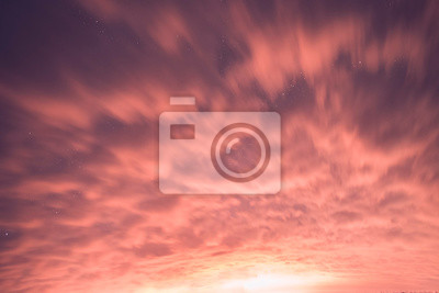 Colorful orange clouds on the sky.