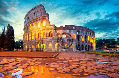 Fototapeta Colosseum morning in Rome, Italy. Colosseum is one of the main attractions of Rome. Coliseum is reflected in puddle. Rome architecture and landmark.