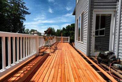 Fototapeta Complete home outdoor deck remodel with new red cedar wooden boards being installed