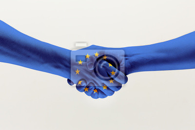 Fototapeta Cooperation agreement. Male hands shaking colored in blue EU flag isolated on gray studio background. Concept of help, commonwealth, unity of European countries, political and economical relations.