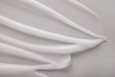 Fototapeta Cosmetic cream milk texture white colored background