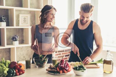 Fototapeta Couple cooking healthy food