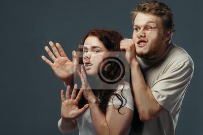Fototapeta Couple faces crushed on glass, funny emotion
