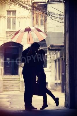 Fototapeta Couple kissing at patio