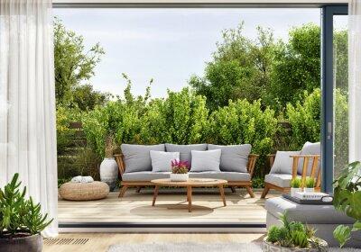 Fototapeta Cozy patio area with garden furniture, sliding doors and decking