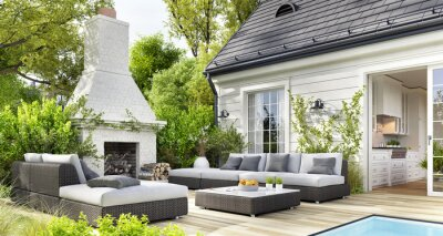 Fototapeta Cozy patio area with garden furniture, swimming pool and outdoor fireplace