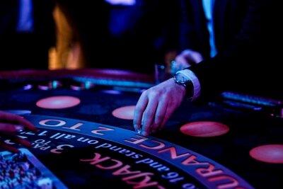 Fototapeta Cropped Hands Of People Gambling In Casino
