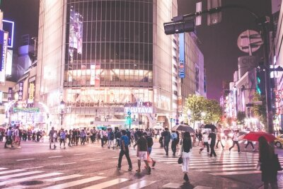 Crowd Crossing Road In Illuminated City At Night