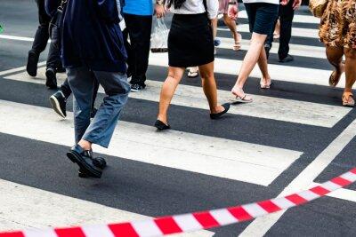 Crowd crossing the pedestrian crossing