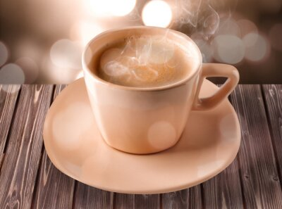 Cup of coffee with foam on light background
