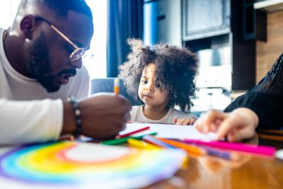 Fototapeta cute curly afro hair girl drawing with her dad parents positive education tolerance
