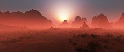 Fototapeta Czerwona pustynia skalista krajobraz we mgle na zachodzie słońca. Panoramiczne strzał