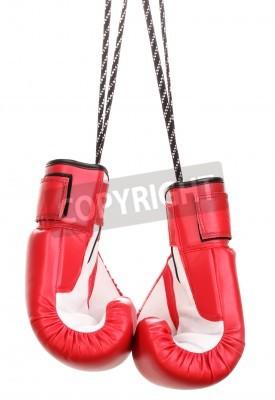 Fototapeta Czerwone rękawice bokserskie wiszące na białym