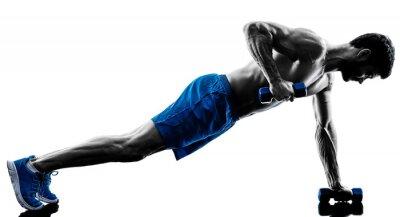 Fototapeta człowiek wykonywania ćwiczeń deski pozycję centrum fitness sylwetka