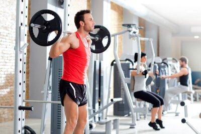 Fototapeta Człowiek z wagi hantle szkoleń sala gimnastyczna