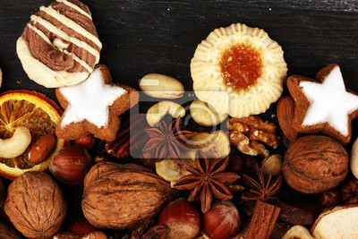 Decoration with christmas cookies. Typical cinnamon stars with fruits and nuts cinnamon