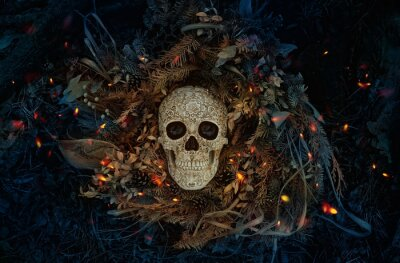 Fototapeta Decorative human skull on dark natural mistery background. magical esoteric ritual. symbol of samhain sabbat. Mysticism, divination, wicca, occultism, Witchcraft concept. flat lay