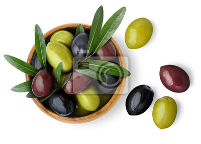 Fototapeta Delicious black, green and red olives with leaves in a wooden bowl, isolated on white background, view from above