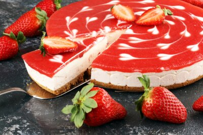 Delicious strawberry cheesecake with berries on grey rustic background