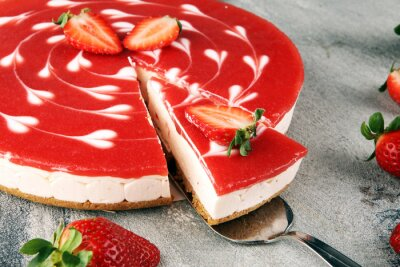 Delicious strawberry cheesecake with berries on stone rustic background