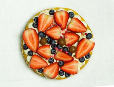 Fototapeta Delicious tart with fresh strawberries, raspberries and currants on the table. top view horizontal