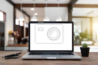 Fototapeta Desk Laptop with blank screen on table of coffee