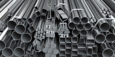 Fototapeta Different metal rolled products. Stainless steel profiles and tubes. in warehouse background.