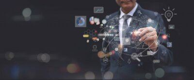Fototapeta Digital marketing, Global business, IoT Internet of Things, business strategy concept. Businessman touching on global network with technology icons