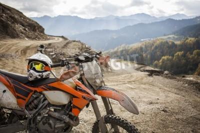 Fototapeta Dirty enduro motorcycle motocross helmet on road