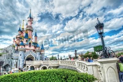Fototapeta Disney Castle and bridge on a bright sunny day