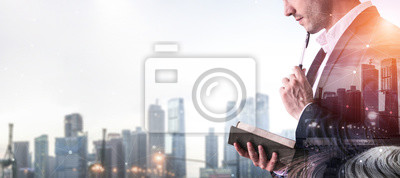 Fototapeta Double Exposure Image of Business Person on modern city background. Future business and communication technology concept. Surreal futuristic cityscape and abstract multiple exposure graphic interface.