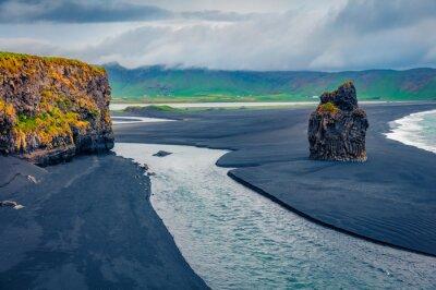 Fototapeta Dramatic summer scenery. Gloomy summer view of nature reserve - Reynisfjara Beach, Vik location, Iceland, Europe. Amazing seascape of Atlantic ocean with black sand beach.