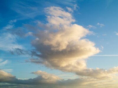 Fototapeta Dramatic white fluffy clouds on a blue sky. Nature background