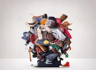 Fototapeta Duża kupa różnych ubrań i butów