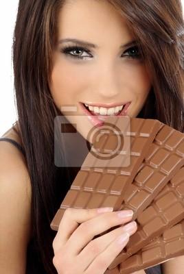 Fototapeta Dziewczyna Chocolate. Sexy dziewczyna z dużego bloku czekolady