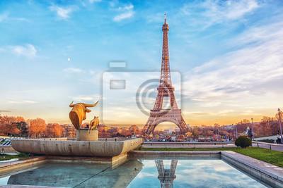 Fototapeta Eiffel Tower at sunset in Paris, France. Romantic travel background