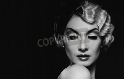 Fototapeta Elegant blond retro woman  wearing little hat with beautiful hairdo and red lipstick