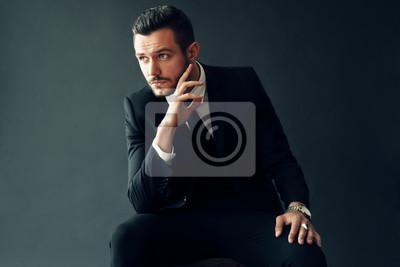 Fototapeta Elegant young man portrait on black background