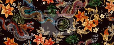 Fototapeta Embroidery asian dragon and beautiful yellow daffodils flowers seamless pattern. Oriental style. Japan and China art
