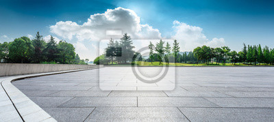 Fototapeta Empty square floor and green woods natural scenery in city park
